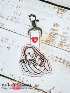 Unborn Baby In His Hands