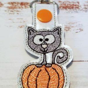 Cat In Pumpkin Snap Tab